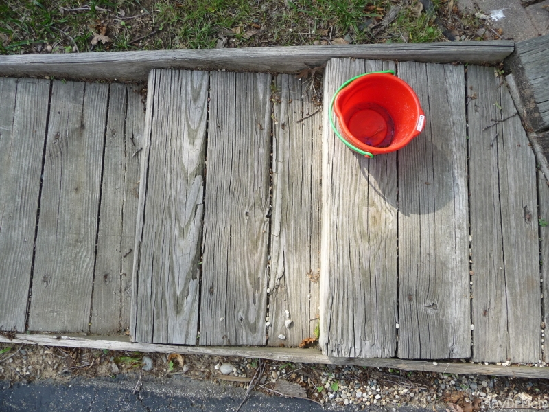 Red Bucket on Stairs: From Above