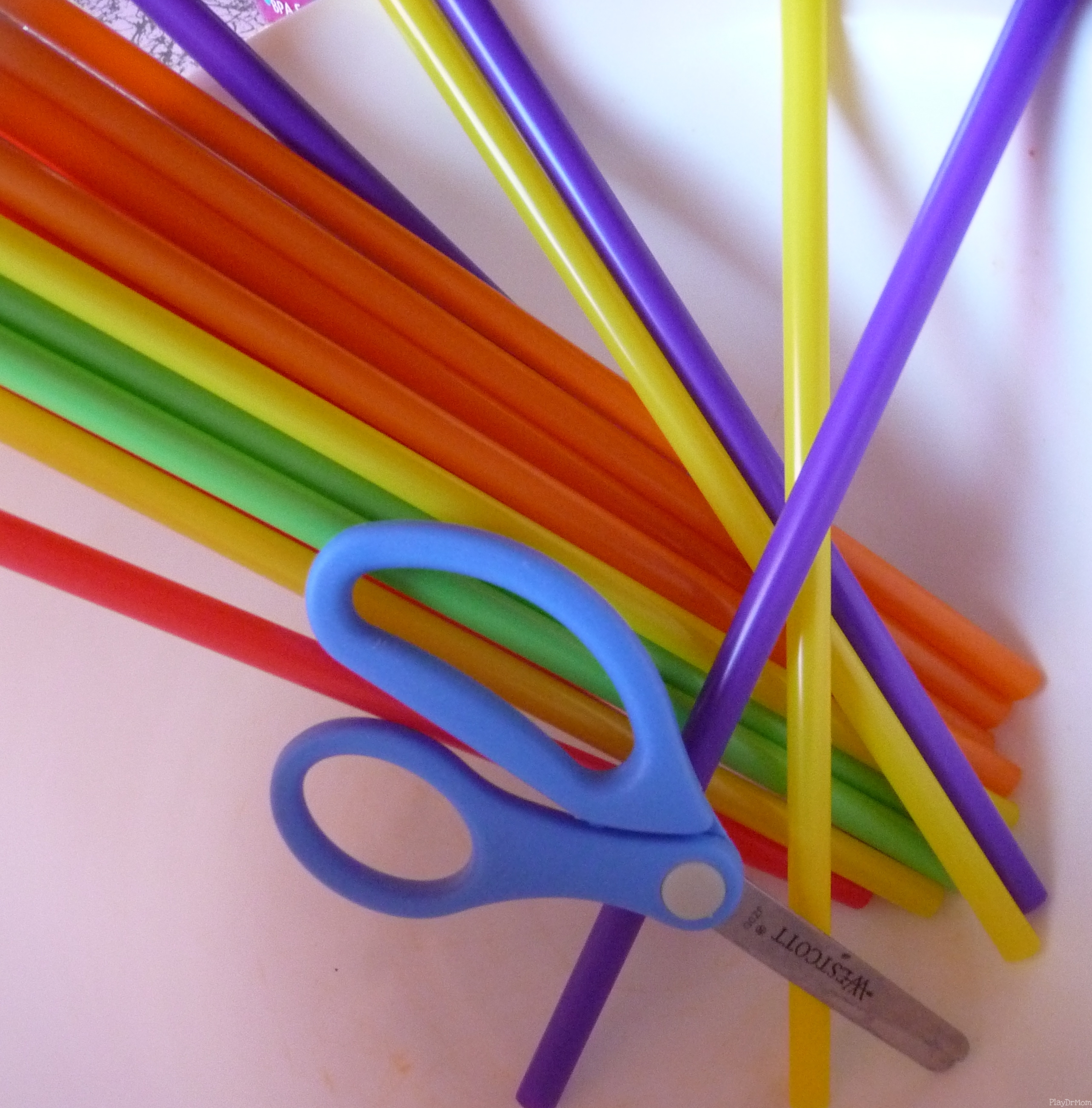 Supplies: Colored Straws and child scissors
