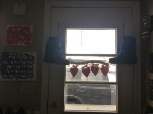 boots hanging on door and painting upside-down