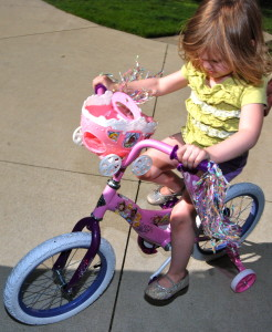 learning to ride her big girl bike