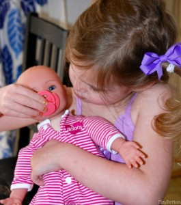 pacifier with baby doll